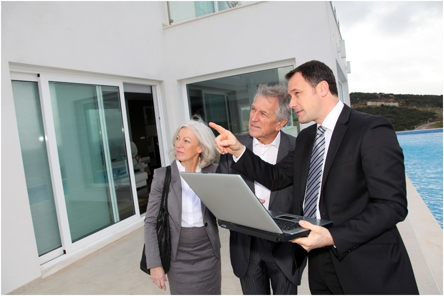 Man showing house details to clients